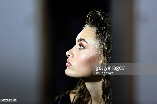 An alternative view of a model backstage prior to the Top Shop unique show during London Fashion Week Spring/Summer collections 2017 at Old...