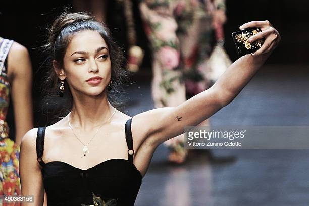 An alternative view of a model walks the runway during the Dolce Gabbana fashion show as part of Milan Fashion Week Spring/Summer 2016 on September...