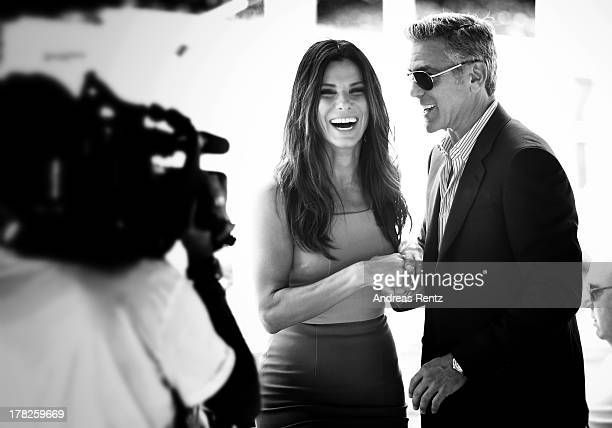 An alternative view of actors Sandra Bullock and George Clooney who attend the 'Gravity' photocallthe 70th Venice International Film Festival on...