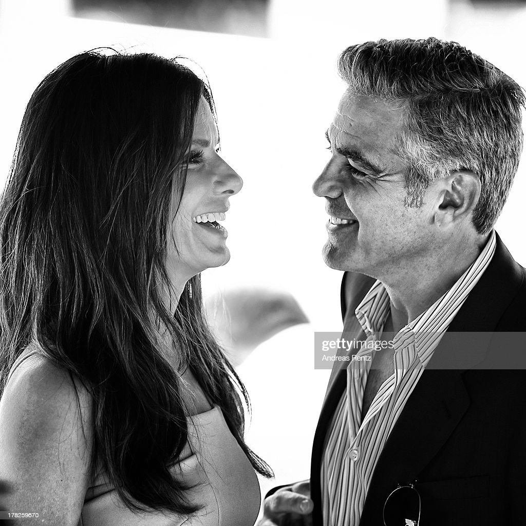 An alternative view of actors Sandra Bullock and George Clooney who attend the 'Gravity' photocallthe 70th Venice International Film Festival on August 28, 2013 in Venice, Italy.