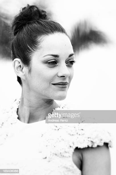 An alternative view of actress Marion Cotillard as she attends 'The Immigrant' photocall during The 66th Annual Cannes Film Festival at he Palais des...