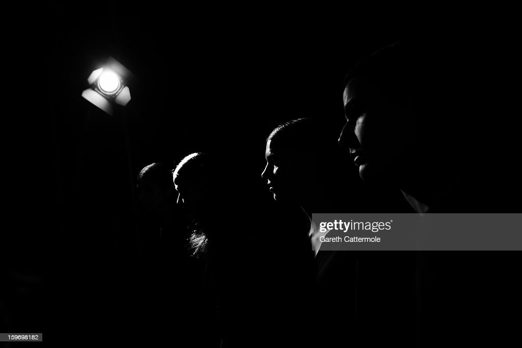 An alternative view of models backstage ahead of the Dawid Tomaszewski Autumn/Winter 2013/14 fashion show during the Mercedes-Benz Fashion Week Berlin at the Brandenburg Gate on January 18, 2013 in Berlin, Germany.