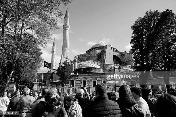 An alternative view of people queuing up outside Hagia Sophia on October 18 2014 in Istanbul Turkey