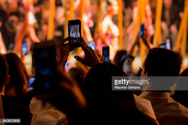 An alternative view of the audience with cellphones in instagram facebook live and snapchat during Sao Paulo Fashion Week N44 SPFW Winter 2018 at...