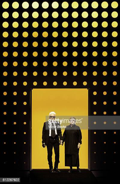 An alternative view on designers Karl Lagerfeld and Silvia Venturini Fendi acknowledging the applause of the public after the Fendi show during Milan...