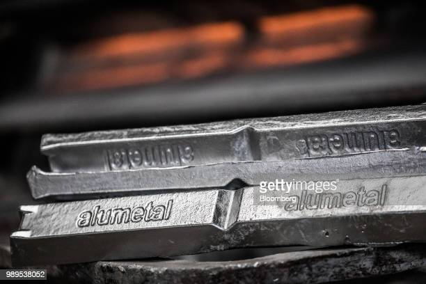 An Alumetal logo sits on aluminum ingots in a warehouse ahead of shipping at the Alumetal Group Hungary Kft aluminium processing plant in Komarom...