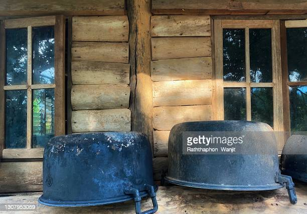 an aluminum pot is place outside the kitchen. - 薪 ストックフォトと画像