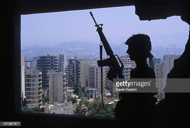 An Amal militia man armed with an M16 automatic assault rifle stands at a sniper position outside Bourj elBarajneh Palestinian refugee camp in the...