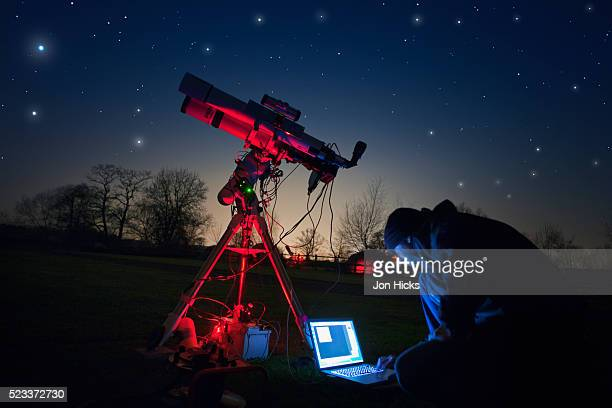 an amateur astronomer at a star party in herefordshire. - astronomy stock pictures, royalty-free photos & images