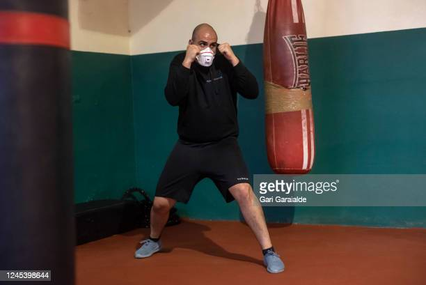 An amateur boxer wearing a protective face mask do some exercise during a training session at the Team Latigo Boxing Club on June 04, 2020 in...