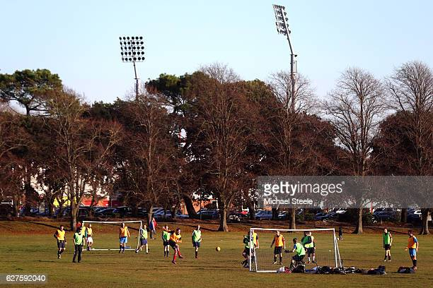 An amateur football match is played on a park infront of the Vitality Stadium prior to the Premier League match between AFC Bournemouth and Liverpool...