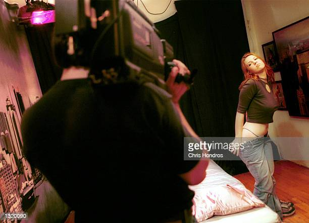 An amateur model is videotaped undressing during the shooting of a pornographic video December 15 2000 in New York Research groups predict that Web...