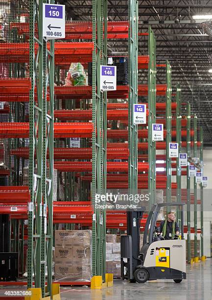 An Amazon Associate drives a forklift among the shelves at an Amazon Fulfillment Center on February 13 2015 in DuPont Washington The eighth...