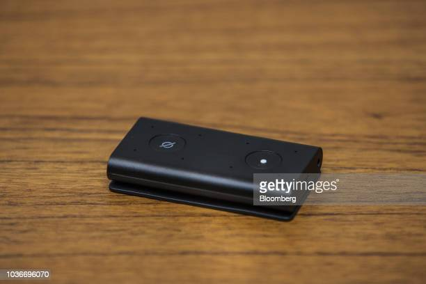 An Amazon Echo Auto smart device sits on display at the Amazoncom Inc Spheres headquarters during an unveiling event in Seattle Washington US on...