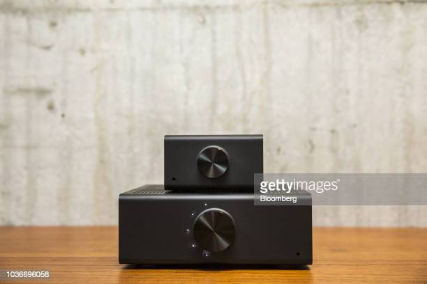 An Amazon Echo Link music streaming device top and Link Amp music streaming device and amplifier sit on display at the Amazoncom Inc Spheres...