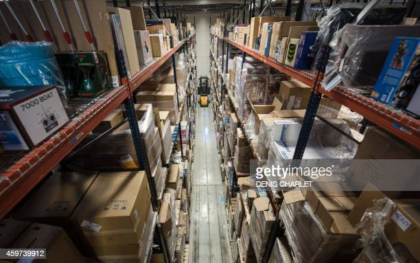 PAYSANT An Amazon employee drives a forklift in a logistic site of the US online sales giant on November 26 2014 in LauwinPlanque northern France...