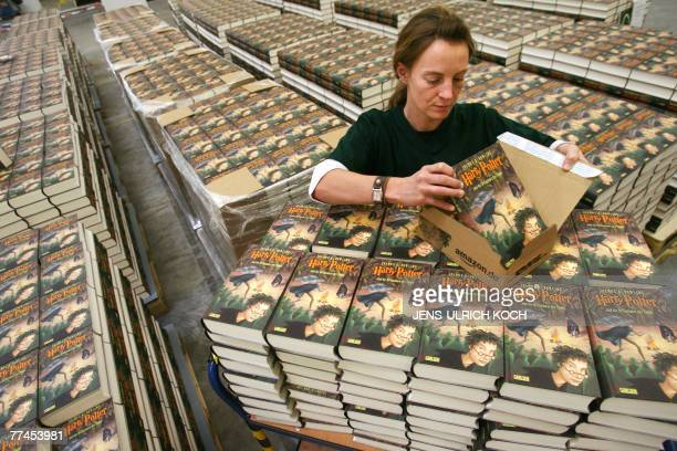 An Amazon employee packs the German version of the latest book of the Harry Potter series 'Harry Potter and the Deathly Hallows' authored by J K...