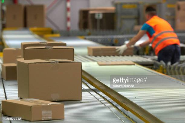An amazon employee working in the goods dispatch area of the Amazon logistics centre in Werne Germany 12 November 2015 The online shop is introducing...
