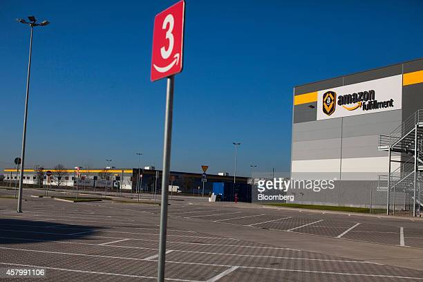 An Amazon fulfilment logo sits on the exterior of Amazon Inc's new fulfilment center on its official day of opening in Bielany Wroclawskie Poland on...