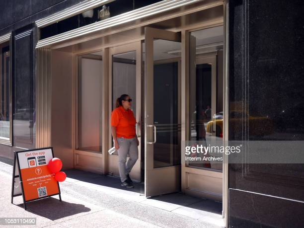 An Amazon Go employee stands outside the entrance of the building housing the second Amazon Go store to open in Chicago Illinois October 9 2018 The...