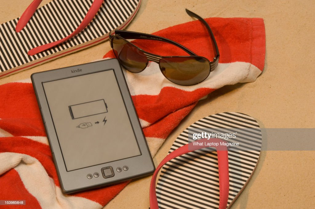 An Amazon Kindle, shot in a beach scenario during a holiday technology feature, February 6, 2012.