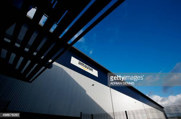 An Amazon logo hangs on a wall outside an Amazoncouk fulfillment centre in Hemel Hempstead north of London on November 25 2015 Shops could be seeing...