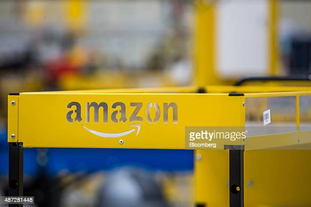 An Amazon logo sits on a collection cart for customer orders on the opening day of the new AmazonCom Inc fulfillment center in Dobroviz Czech...