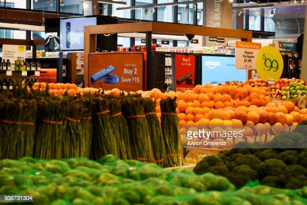 An Amazon PopUp in the Union Station Whole Foods stands in the produce department on Thursday March 22 2018 Amazon is having an effect on the Denver...