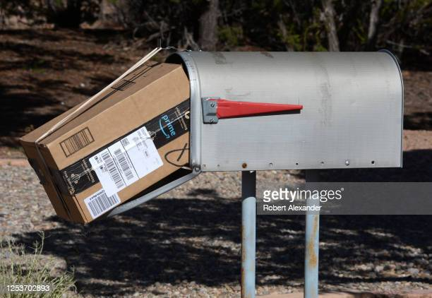 An Amazon Prime package delivered to a mailbox by a U.S. Postal Service mailman in Santa Fe, New Mexico.