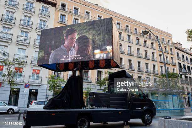 """An Amazon Prime Video truck with a double giant led screen projects the movie """"Modern Love"""" as part of the Cine de Balcon project on April 14, 2020..."""