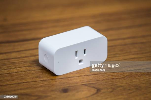 An Amazon Smart Plug outlet sits on display at the Amazoncom Inc Spheres headquarters during an unveiling event in Seattle Washington US on Thursday...