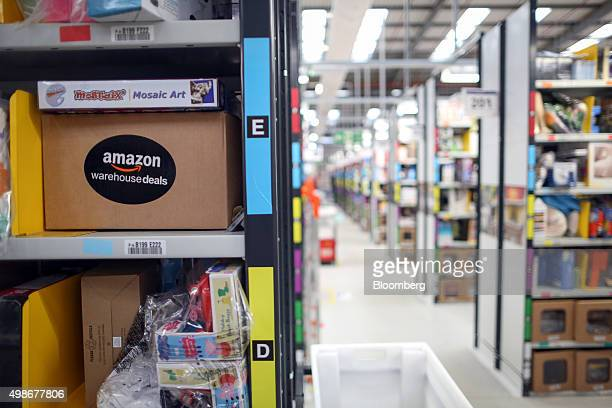 An Amazon warehouse deals box sits on a shelf at the Amazoncom Inc fulfillment center in Hemel Hempstead UK on Wednesday Nov 25 2015 WalMart and...