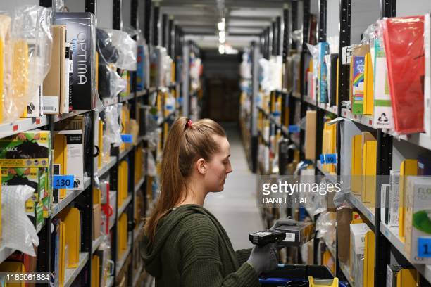 An Amazon worker sorts items at the Amazon Fulfilment Centre in Peterborough east England on November 27 as preparations are underway for the annual...