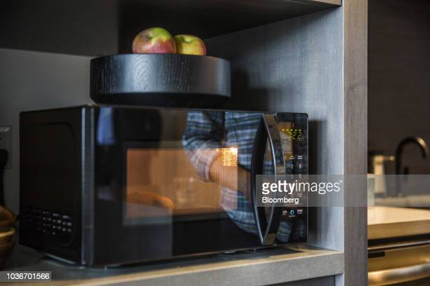 An AmazonBasics Microwave sits on display during an unveiling event at the Amazoncom Inc Spheres headquarters in Seattle Washington US on Thursday...