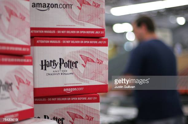 An Amazoncom employee packs copies of the new book 'Harry Potter and the Deathly Hallows' for shipment July 16 2007 at an Amazon fulfillment center...