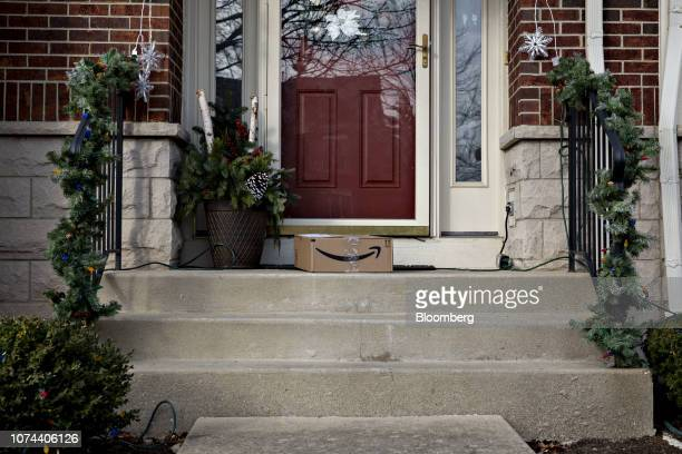 An Amazoncom Inc box sits on the front steps of a home in the Glen housing development in Glenview Illinois US on Wednesday Dec 12 2018 Converted...