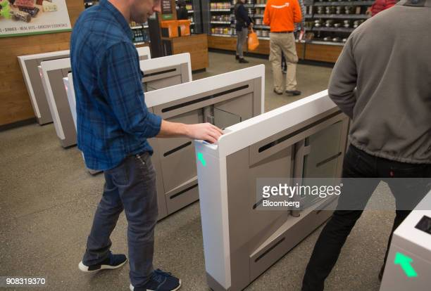 An Amazoncom Inc employee scans in to shop at the Amazon Go store in Seattle Washington US on Wednesday Jan 17 2018 After more than a year of testing...