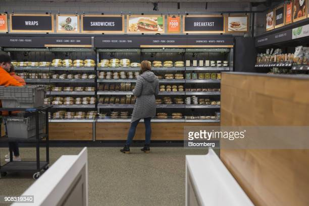 An Amazoncom Inc employee shops for prepared food at the Amazon Go store in Seattle Washington US on Wednesday Jan 17 2018 After more than a year of...