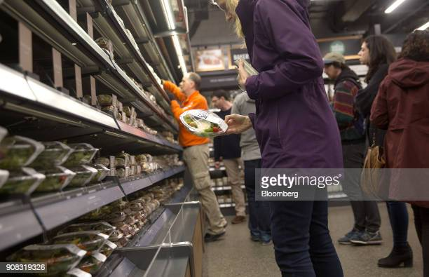 An Amazoncom Inc employee shops for salad at the Amazon Go store in Seattle Washington US on Wednesday Jan 17 2018 After more than a year of testing...