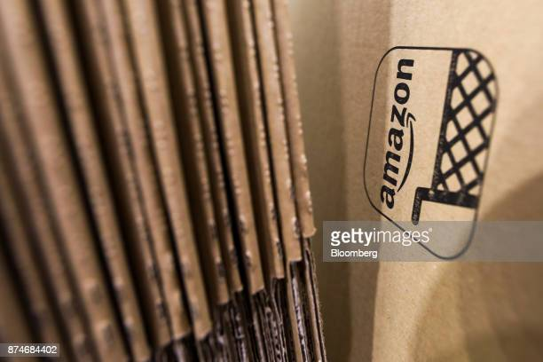 An Amazoncom Inc logo sits on cardboard packaging at the company's fulfillment center in Peterborough UK on Wednesday Nov 15 2017 As Amazon's share...