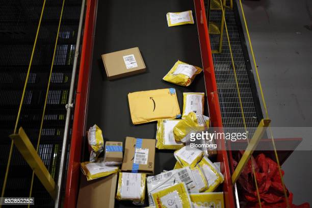 An Amazoncom Inc package moves down a conveyor belt while being sorted at the DHL Worldwide Express hub of Cincinnati/Northern Kentucky International...