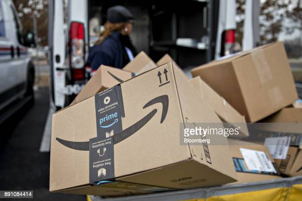 An Amazoncom Inc package sits in a bin before being placed on a delivery vehicle at the United States Postal Service Joseph Curseen Jr and Thomas...