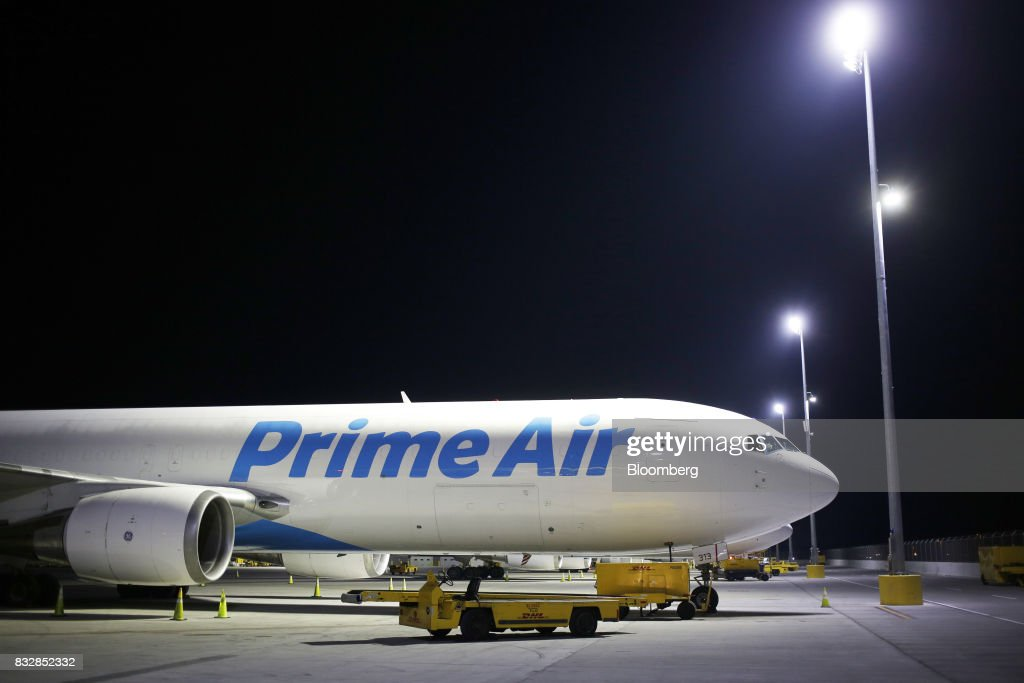 An Amazon.com Inc. Prime Air cargo jet sits parked at the DHL Worldwide Express hub of Cincinnati/Northern Kentucky International Airport in Hebron, Kentucky, U.S., on Wednesday, Aug. 16, 2017. The Deutsche Post AG, parent company to Worldwide Express, second-quarter operating profit jumped 12 percent as the German mail operator handled more express deliveries and won more business at its logistics unit. Photographer: Luke Sharrett/Bloomberg via Getty Images
