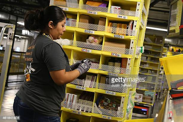 An Amazoncom worker picks orders at an Amazon fulfillment center on January 20 2015 in Tracy California Amazon officially opened its new 12 million...