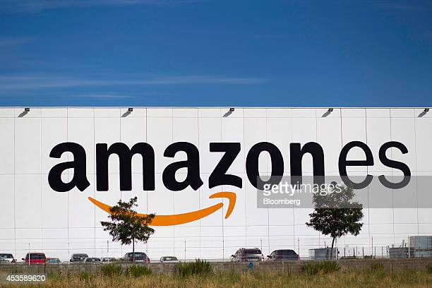 An Amazones logo sits on display outside the fulfilment center operated by Amazoncom Inc in Alcala de Henares Spain on Wednesday Aug 13 2014 Webbased...