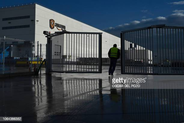 An Amazon's driver crosses the gate of the electronic commerce and cloud computing company's biggest facilities in Spain as workers went on strike in...