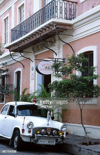 An Ambassador car sits outside the Hotel de L'Orient in Pondicherry a former French colony near Chennai in southern India Home to a substantial...