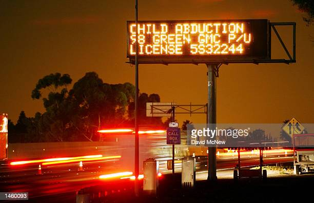 An Amber Alert freeway sign reads CHILD ABDUCTION giving a description of a vehicle suspected of being used in a Los Angeles kidnapping before dawn...