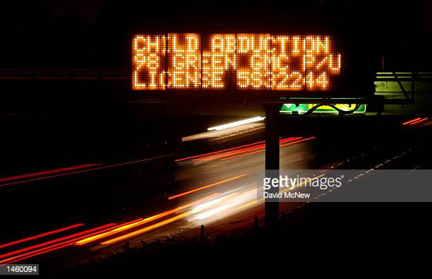 An Amber Alert freeway sign reads 'CHILD ABDUCTION' giving a description of a vehicle suspected of being used in a Los Angeles kidnapping before dawn...