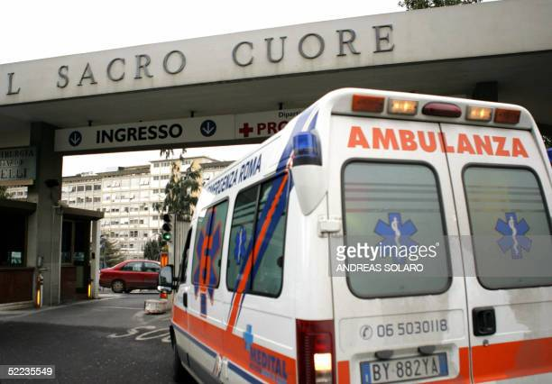An ambulance arrives 24 February 2005 at the Policlinico Gemelli Hospital in Rome where Pope John Paul ll was hospitalized earlier in the day with a...